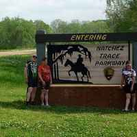 Mississippi - Four cyclists at the Southern Terminus of the Natchez Trace Parkway.