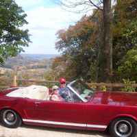 Our 1965 Ford Mustang Convertible on Old Trace Drive behind the Tobacco Barn next to the overlook into the Duck River Valley.
