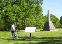 Cyclist learning about Meriwether Lewis.