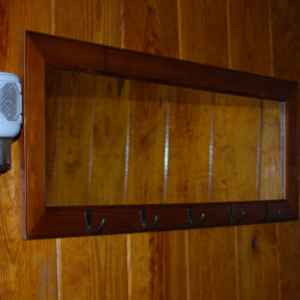 Mirror and coat hooks