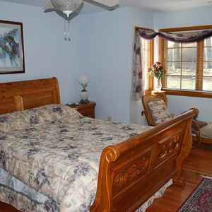 Downstairs guest room with queen size bed and adjoining bathroom.