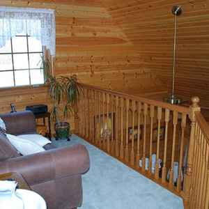 Upstairs sitting area overlooking the living room.