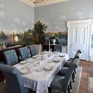 The Dining Room with its rare mural walls installed in 1900.