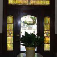 Front door with stained glass windows.