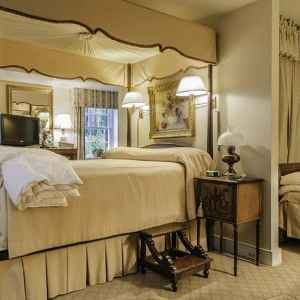 Suite 1 - Antique canopied queen bed and a twin day bed.