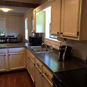 Fully equipped kitchen and a stacked washer/dryer.