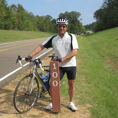 Cyclist looking north at milepost 100 on the Natchez Trace Parkway.