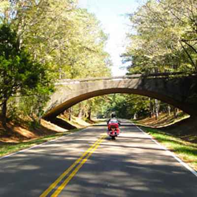 Motorcycle passing under the Highway 27 overpass on the Natchez Trace Parkway.