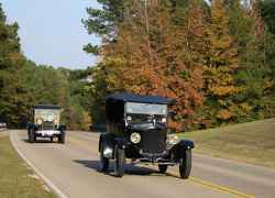 Antique cars traveling towards Tupelo.