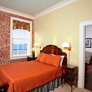 Bedroom with a Queen Bed and View of the Mississippi River