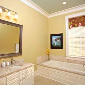 En-suite bathroom with Jacuzzi bath and separate walk in shower