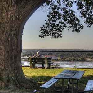 Sit on a park bench in Natchez, MS and watch the Mississippi River roll by.