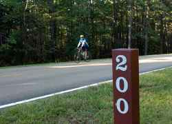 Cyclist gliding past milepost 200 in Central Mississippi.